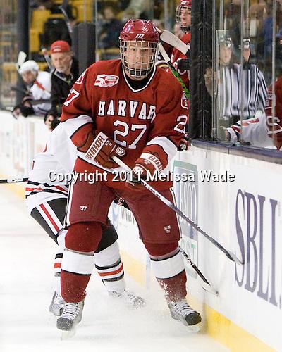 The Northeastern University Huskies defeated the Harvard University Crimson 4-0 in their Beanpot opener on Monday, February 7, 2011, at TD Garden in Boston, Massachusetts.