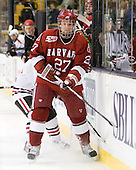 The Northeastern University Huskies defeated the Harvard University Crimson 4-0 in their Beanpot opener on Monday, February 7, 2011, at TD Garden in Boston, Massachusetts.