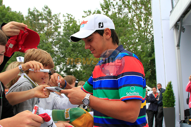 Matteo Manassero (ITA) signs autographs after finishing his round during Day 3 of the BMW International Open at Golf Club Munchen Eichenried, Germany, 25th June 2011 (Photo Eoin Clarke/www.golffile.ie)