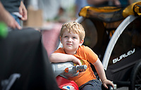 NWA Democrat-Gazette/CHARLIE KAIJO Bodhi Krause, 4, of Bentonville looks on as he listens to music acts, Saturday, May 12, 2018 at the Town Square in Bentonville. <br />