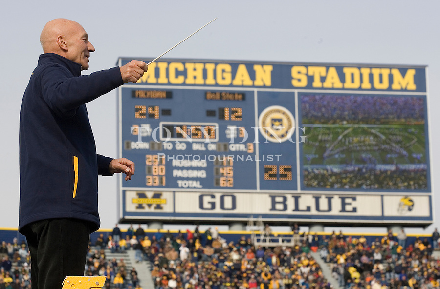 4 November 2006: Actor Patrick Stewart, famous for playing the Star Trek character Captain Jean-Luc Picard, conducts the Michigan Marching Band at a half-time show, during No. 2 Michigan's 34-26 win over MAC opponent Ball State at Michigan Stadium in Ann Arbor, MI. This was the two school's first meeting on the football field and Michigan's last home game of the season. The Wolverines go on the road at Indiana next week and finish in Columbus to face the No. 1 Ohio State Buckeyes.