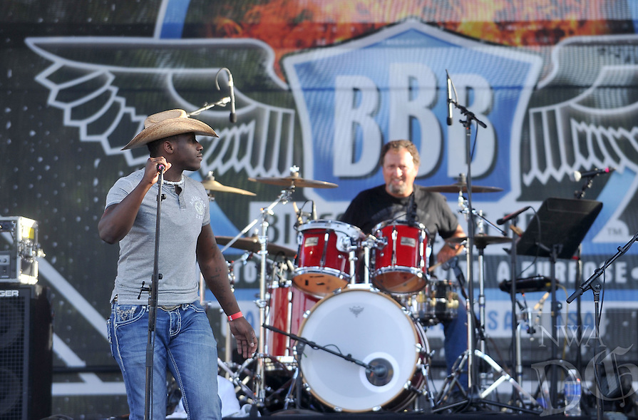 NWA Democrat-Gazette/MICHAEL WOODS • @NWAMICHAELW<br /> Country singer Milton Patton performs on the main stage to kick off the live music for the 16th annual Bikes Blues and BBQ on Dickson Street in Fayetteville Wednesday September 23, 2015.