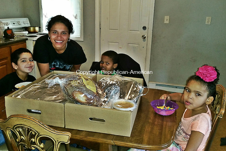 WATERBURY -- Nov. 27, 2015 -- 26_NEW_112715MDP01 -- Nicole Montero, is a single mother raising four children, was thankful Thursday to receive a Thanksgiving meaol from Acts 4 Ministry, which had previously given the family a set of furniture after bedbugs forced them from their former apartment. Her children, left to right, are Jhourdan Vazquez, 7, Jahmair Pearson, 5, and Judy Pearson, 4. Not pictured is 1-year-old Michael Rivera.