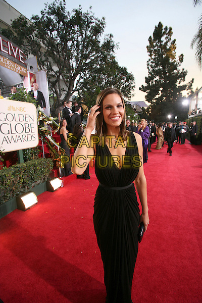 HILARY SWANK.63rd Annual Golden Globe Awards - Arrivals held at the Beverly Hills Hilton, Beverly Hills, California, USA..January 16th, 2006.Ref: AW.globes full length black dress plunging neckline.www.capitalpictures.com.sales@capitalpictures.com.Supplied By Capital Pictures.