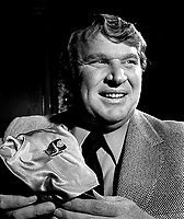 Oakland Raider coach John Madden holding the SuperBowl ring...(1977 photo/Ron Riesterer)