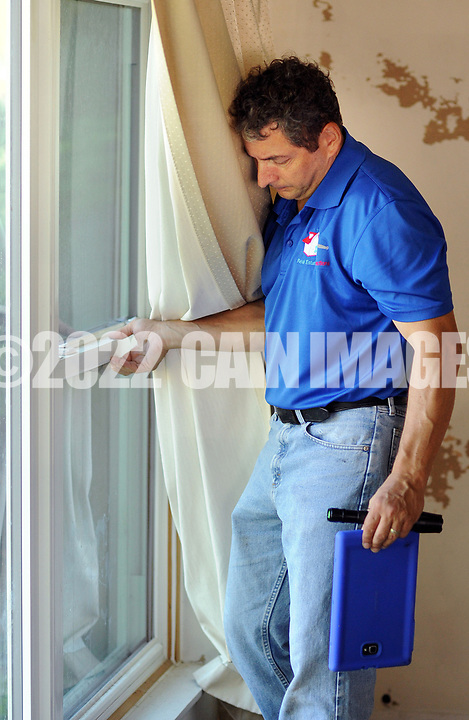 Home inspector Frank Castiglione of Real Estate Inspections, checks windows at a home for possible problems Thursday, September 28, 2017 in Plymouth Meeting, Pennsylvania. (WILLIAM THOMAS CAIN / For The Philadelphia Inquirer)