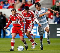 Chicago Fire forward Pascal Bedrossian (13), Chicago Fire midfielder Ivan Guerrero (23), and FC Dallas midfielder Pablo Ricchetti (6) pursue a loose ball.  FC Dallas defeated the Chicago Fire 2-1 at Toyota Park in Bridgeview, IL on May 17, 2007.
