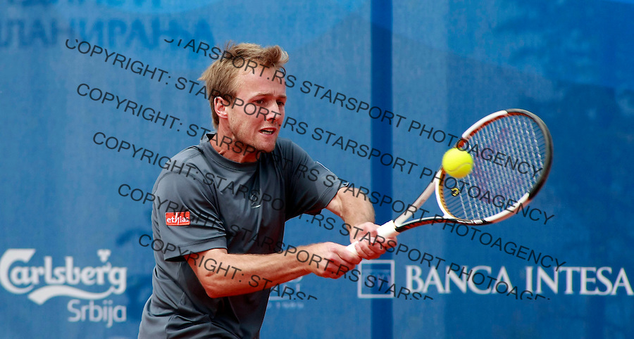 Belgium player Cristophe Rochus returns the ball to Nicolas Devilder, from France, during their tennis match in first round, at the Serbia Open 2009 tennis tournament in Belgrade, Monday, May 4, 2009. (Srdjan Stevanovic/Starsportphoto.com)