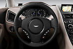 Steering wheel view of a 2012 - 2014 Aston Martin Vanquish 2+2 Coupe.