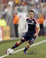 New England Revolution substitute midfielder Kelyn Rowe (11) maintains control as he brings the ball forward. In a Major League Soccer (MLS) match, Montreal Impact defeated the New England Revolution, 1-0, at Gillette Stadium on August 12, 2012.