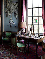 An expressive painted cornucopia of foliage and hunted animals adorns one of the walls in the 'gentlemen's sitting room'
