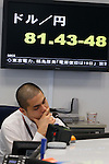 March 18, 2011, Tokyo, Japan - The U.S. dollar soars over 81-yen level during a morning foreign exchange trade in Tokyo on Friday, March 18, 2011. The yen, which had risen about five percent over the past week, gave up a large part of those gains within minutes of the statement from the Group of Seven nations. (Photo by Yusuke Nakanishi/AFLO) [1090] -mis-
