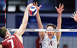 KENOSHA, WI - APRIL 28:  Springfield's Sean Zuvich blocks a spike from Stevens Institute's Jack Bittker at the Division III Men's Volleyball Championship held at the Tarble Athletic and Recreation Center on April 28, 2018 in Kenosha, Wisconsin. (Photo by Steve Woltmann/NCAA Photos via Getty Images)
