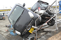 In the wake of a massive tsunami that ripped through the Hachinohe port area, two vehicles remained awkwardly entwined. An 8.9-magnitude earthquake triggered the massive tsunami that devastated Japan's eastern seaboard and caused untold damage and loss of life.