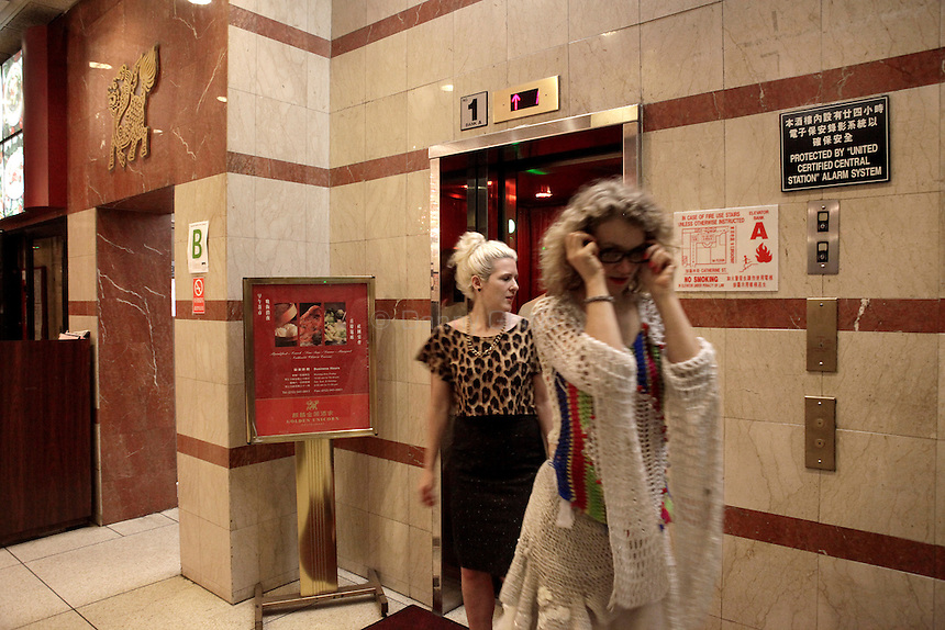 Club-goers leave Madam Wong night club through the lobby of a building in Chinatown. By day Golden Unicorn is a traditional Chinese restaurant, but it is transformed into Madam Wong, a trendy Manhattan club at night. ..Danny Ghitis for The New York Times