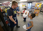 Library Assistant Aubrey White talks with Thomas Lanace, 6, and his brother Alexander, 8, during the Star Wars Day celebration at the Carson City Library in Carson City, Nev. on Wednesday, May 4, 2016.<br />