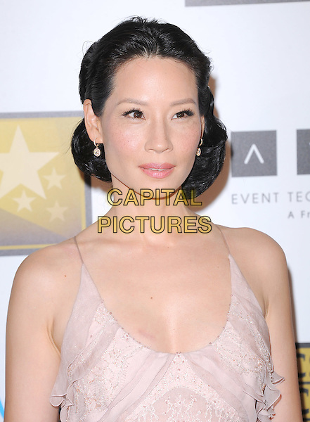 Lucy Liu.The 2nd Annual Critics' Choice Television Awards  held at The Beverly Hilton in Beverly Hills, California, USA..June 18th, 2012.headshot portrait pink beige.CAP/RKE/DVS.©DVS/RockinExposures/Capital Pictures.