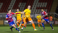Garry Thompson of Wycombe Wanderers holds off Dominic Hyam of Dagenham & Redbridge during the Sky Bet League 2 match between Dagenham and Redbridge and Wycombe Wanderers at the London Borough of Barking and Dagenham Stadium, London, England on 9 February 2016. Photo by Andy Rowland.