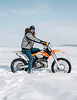 Shane Hetland with his dirt bike on the snow at 39th Annual International Eelpout Festival, at Leech Lake in Walker, Minnesota, February 23, 2018. Crowds that are more than 10 times the population of tiny Walker, Minn. (pop. 1,069) gather on Minnesota&rsquo;s third largest lake (112,000-acres), Leech Lake, for a festival named for one of the ugliest bottom-dwelling fish, the eelpout.<br /> <br /> Photo by Matt Nager