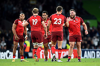 England players celebrate as they're awarded the bonus point try late in the game. Rugby World Cup Pool A match between England and Fiji on September 18, 2015 at Twickenham Stadium in London, England. Photo by: Patrick Khachfe / Onside Images