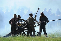 NWA Democrat-Gazette/ANDY SHUPE<br /> Soldiers prepare a cannon to be reloaded Saturday, Sept. 26, 2015, during a re-enactment of the Civil War Battle of Pea Ridge in Pea Ridge. Visit nwadg.com/photos to see more photos from the weekend.
