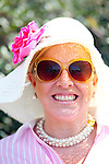 Rita Beckett, of Sugarland, Texas, poses for a portrait outside of Gate 6 after spending the day on the course of The Augusta National Golf Club on the second practice day of the Augusta, Georgia Masters Golf Tournament, April 6, 2010.