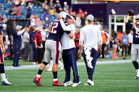 August 9, 2018: New England Patriots quarterback Tom Brady (12) hugs offensive coordinator Josh McDaniels prior to the NFL pre-season football game between the Washington Redskins and the New England Patriots at Gillette Stadium, in Foxborough, Massachusetts.The Patriots defeat the Redskins 26-17. Eric Canha/CSM