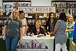 Huntington, New York, U.S. - August 6, 2014 - Hillary Rodham Clinton signs her new memoir, Hard Choices, for SUE MOLLER, of Merrick, wearing a Hillary for 2016 shirt at left, at a book signing event at Book Revue in Huntington, Long Island, during a nationwide tour. Clinton's book is about her four years as America's 67th Secretary of State and how they influence her view of the future.