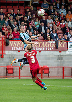 Garry Thompson of Wycombe Wanderers out jumps Christian Scales of Crawley Town during the Sky Bet League 2 match between Crawley Town and Wycombe Wanderers at Checkatrade.com Stadium, Crawley, England on 29 August 2015. Photo by Liam McAvoy.