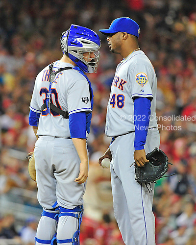 New York Mets catcher Josh Thole (30), left, and Frank Francisco (48), right, discuss strategy in the ninth inning against the Washington Nationals at Nationals Park in Washington, D.C. on Saturday, August 18, 2012.  The Mets won the game 2 - 0..Credit: Ron Sachs / CNP.(RESTRICTION: NO New York or New Jersey Newspapers or newspapers within a 75 mile radius of New York City)