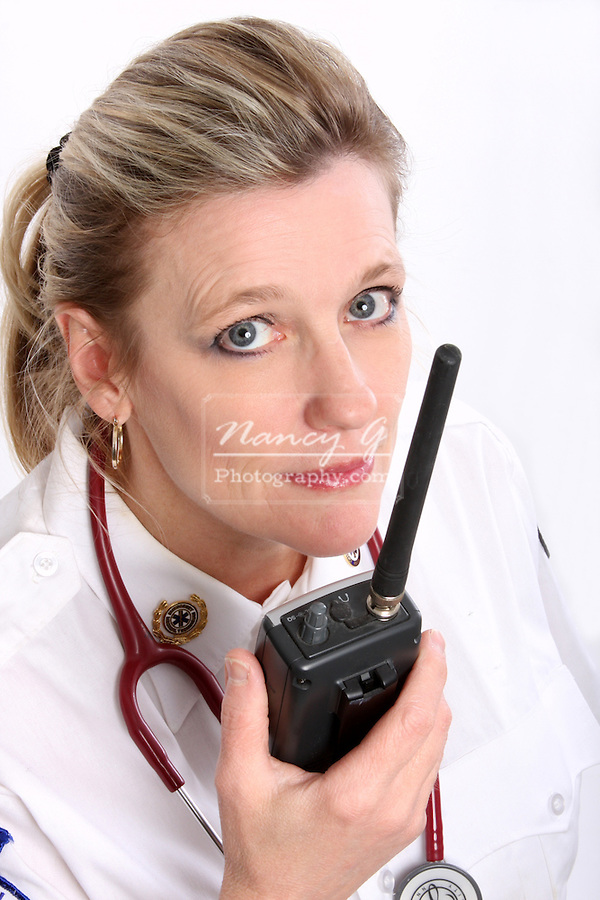 A Wisconsin EMT wearing a stethoscope and talking on a portable radio