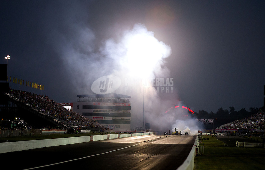 Aug. 30, 2013; Clermont, IN, USA: Overall view of Lucas Oil Raceway as jet cars race during NHRA qualifying for the US Nationals. Mandatory Credit: Mark J. Rebilas-