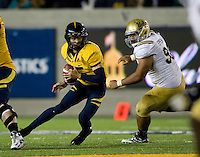 Zach Maynard of California runs the ball away from UCLA defender during the game at Memorial Stadium in Berkeley, California on October 6th, 2012.  California defeated UCLA, 43-17.