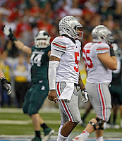 Ohio State Buckeyes quarterback Braxton Miller (5) walks to the sideline after Ohio State Buckeyes didn't make a first down on their last offensive play in the 4th quarter against the Michigan State Spartans defense during the Big 10 Championship game at Lucas Oil Stadium in Indianapolis, Ind on December 7, 2013.  (Dispatch photo by Kyle Robertson)