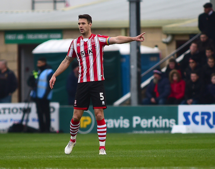 Lincoln City's Jason Shackell<br /> <br /> Photographer Andrew Vaughan/CameraSport<br /> <br /> The EFL Sky Bet League Two - Lincoln City v Mansfield Town - Saturday 24th November 2018 - Sincil Bank - Lincoln<br /> <br /> World Copyright © 2018 CameraSport. All rights reserved. 43 Linden Ave. Countesthorpe. Leicester. England. LE8 5PG - Tel: +44 (0) 116 277 4147 - admin@camerasport.com - www.camerasport.com