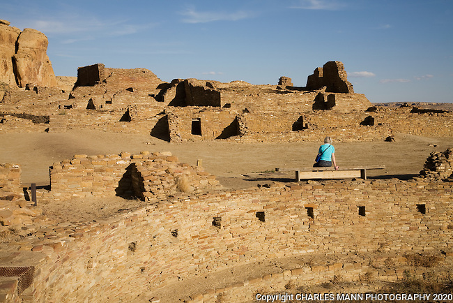 In the late afternoon sun, a  visitor contemplates the ruins of Pueblo Bonito, one of the larger Anasazin Settlements at Chaco Culture National Historical Park in northwest New Mexico.
