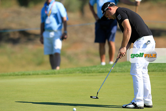 Andy Sullivan (ENG) takes his putt on the 3rd green during Thursday's Round 1 of the 2013 Portugal Masters held at the Oceanico Victoria Golf Club. 10th October 2013.<br /> Picture: Eoin Clarke www.golffile.ie