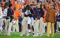 Jan 10, 2011; Glendale, AZ, USA; Auburn Tigers cornerback Chris Davis (11) is helped off the field during the first quarter of the 2011 BCS National Championship game against the Oregon Ducks at University of Phoenix Stadium.  Mandatory Credit: Mark J. Rebilas-