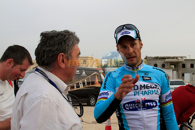 Tom Boonen (BEL) Omega Pharma-Quick Step chats to multiple champion Eddy Merckx at the end of the 3rd Stage of the 2012 Tour of Qatar from Dukhan to Al Gharafa Stadium, Doha, Qatar, 7th February 2012 (Photo Eoin Clarke/Newsfile)