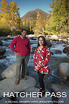 Mao Tosi and Miriam Aarons, 2014 AFN Keynote Speakers pose on boulders in the Little Susitna River, 140925