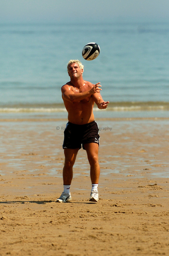 Photo: Jed Wee..Newcastle Falcons Training Session. Guinness Premiership. 18/07/2006..Tom May passes during training at Tynemouth beach.