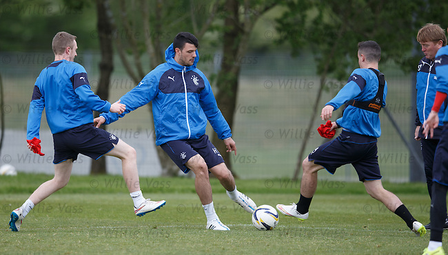 Haris Vuckic with Shane Ferguson and Fraser Aird