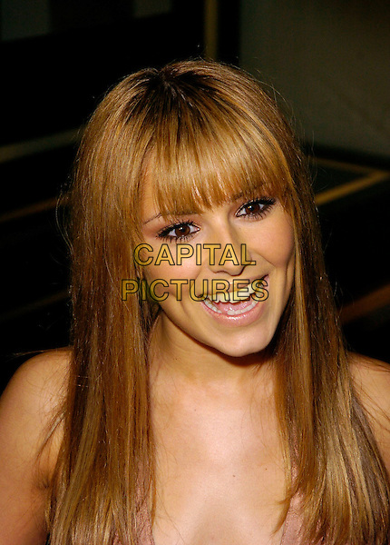 CHERYL COLE.Launch party for the 21st anniversary issue of Elle Magazine at the Versace Store in Sloane Street, London, UK..September 7th, 2006.Ref: CAN.headshot portrait Tweedy .www.capitalpictures.com.sales@capitalpictures.com.©Can Nguyen/Capital Pictures.