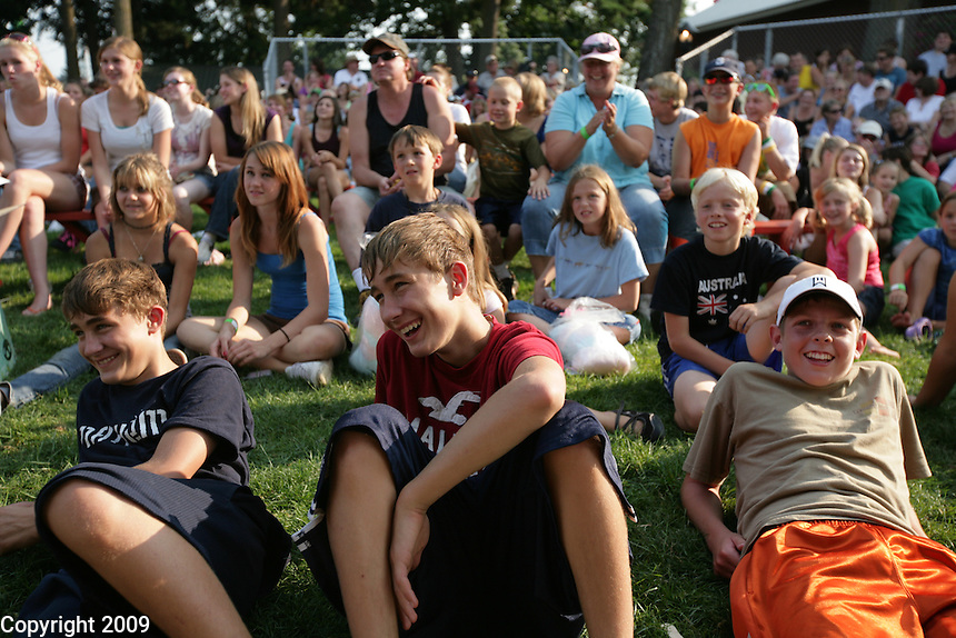 Twins Trevin, left, and Kelby Todd, 14, of Ferndale, and friend Kyle Marks, 15, of Lynden watch a hypnotist. NW Washington Fair. August 16, 2009 PHOTOS BY MERYL SCHENKER ..