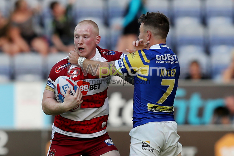 Picture by Paul Currie/SWpix.com - 28/06/2018 - Rugby League - Betfred Super League - Wigan Warriors v Leeds Rhinos - DW Stadium, Wigan, England - Liam Farrell of Wigan Warriors is tackled by Richie Myler of Leeds Rhinos