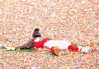 2nd February 2020, Miami Gardens, Florida, USA;  Kansas City Chiefs Defensive End Demone Harris (52)  lays on field of confetti as he celebrates winning the NFL Super Bowl LIV  game against the San Francisco 49ers at the Hard Rock Stadium in Miami Gardens