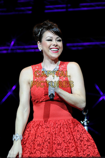 Lisa Scott-Lee of Steps.Performing at the PWL Hit Factory Live, o2 Arena, London, England, UK, .21st December 2012..music live on stage concert gig half length red lace dress microphone smiling .CAP/MAR.© Martin Harris/Capital Pictures.