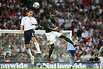 28 May 2008: Rio Ferdinand (ENG) (5) and Eddie Johnson (USA) (r) challenge for a header. The England Men's National Team defeated the United States Men's National Team 2-0 at Wembley Stadium in London, England in an international friendly soccer match.