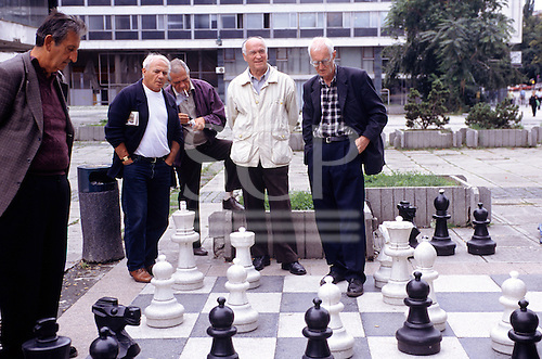 Sarajevo, Bosnia. Old men playing a game of pavement chess.