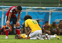 Neymar of Brazil goes down with an injury before being stretchered off